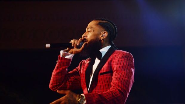 Nipsey Hussle performs onstage at the Warner Music Pre-Grammy Party