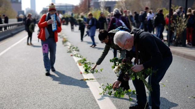 Extinction Rebellion activists lay flowers on Waterloo Bridge