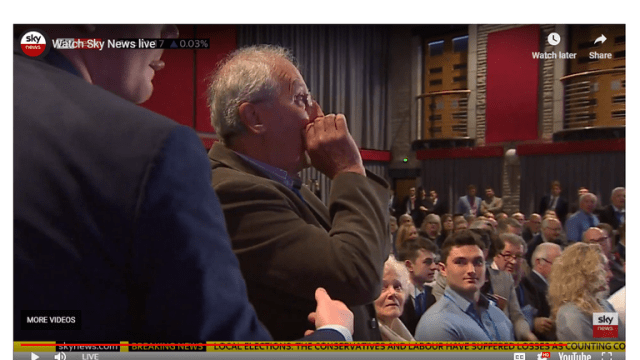 Theresa May was heckled by a man in the audience at the Conservatives' Spring confererence in Wales.