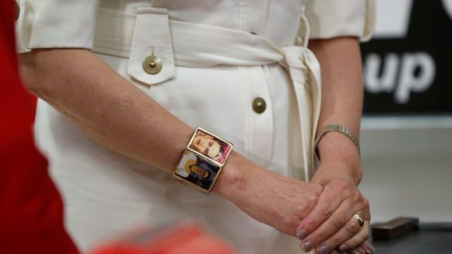 Britain's Prime Minister Theresa May wears a Frida Kahlo bracelet