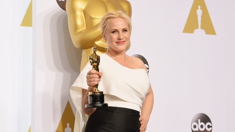 Patricia Arquette poses with her Oscar for best supporting actress for Boyhood in the press room during the 87th Annual Academy Awards at Loews Hollywood Hotel on February 22, 2015