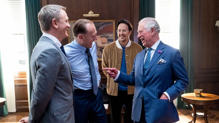 The Prince of Wales with (left to right) actors Daniel Craig, Ralph Fiennes and director Cary Joji Fukunaga during a visit to the set of the 25th James Bond film at Pinewood Studios in Iver Heath, Buckinghamshire.