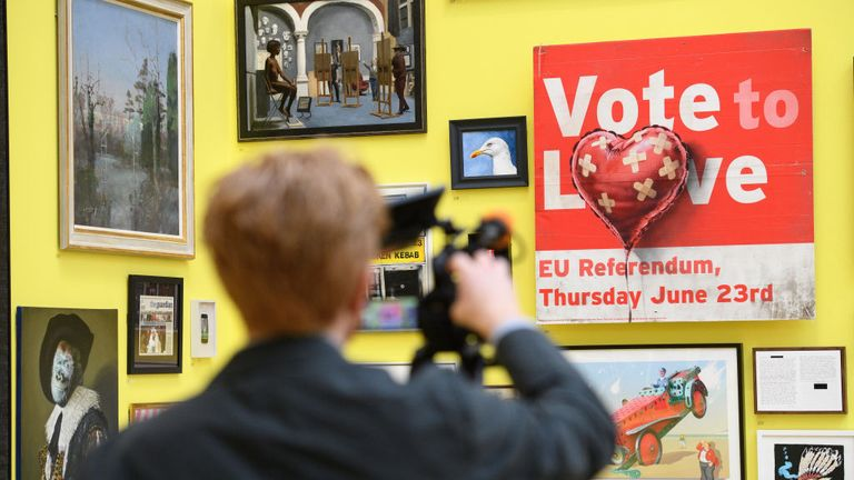 "A man films ""Vote to Love"" by Banksy (£350m)"