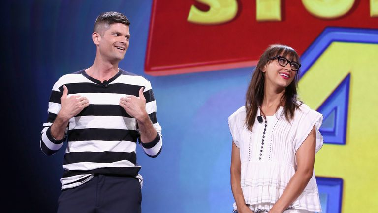 """ANAHEIM, CA - AUGUST 14: Writers Will McCormack (L) and Rashida Jones of TOY STORY 4 took part today in """"Pixar and Walt Disney Animation Studios: The Upcoming Films"""" presentation at Disney's D23 EXPO 2015 in Anaheim, Calif. (Photo by Jesse Grant/Getty Images for Disney)"""