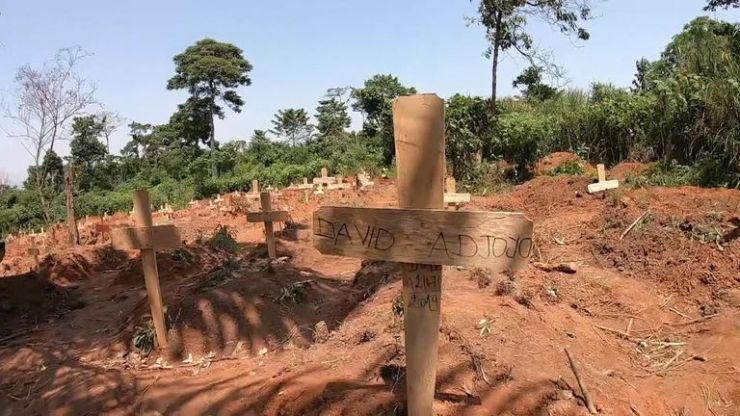 An ad-hoc burial site for Ebola victims has been set up in a forest