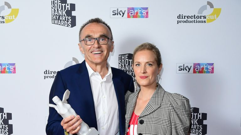 Danny Boyle with the Visual Art Award , presented by Polly Morgan, at the South Bank Sky Arts Awards at the Savoy Hotel in London. PRESS ASSOCIATION Photo. Picture date: Sunday July 7, 2019. See PA story SHOWBIZ Arts. Photo credit should read: Ian West/PA Wire