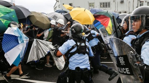 Police try to disperse protesters