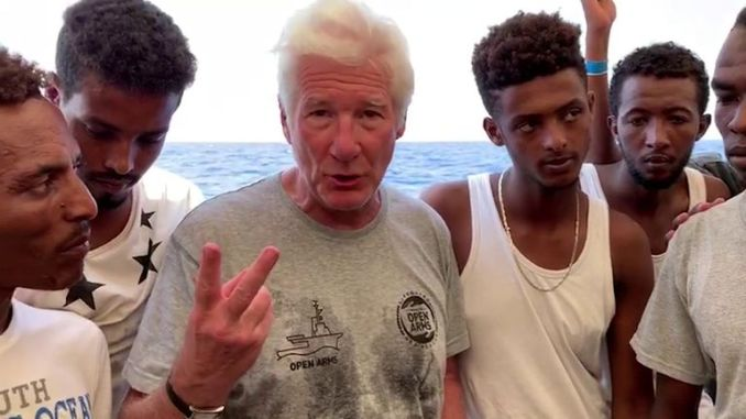 Actor Richard Gere on board the ship carrying 121 migrants who no European country is offering to accept
