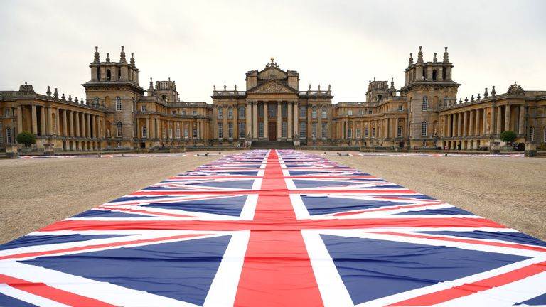 A giant walkway of flags created by artist Maurizio Cattelan is part of the exhibition at Blenheim Palace