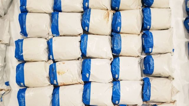 National Crime Agency and Border Force Officers at the scene where packs of heroin with a street value of more than £120m has been discovered hidden under towels and dressing gowns on board a container ship