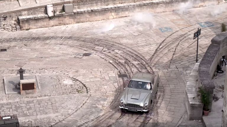 A car chase on the set of the new James Bond movie No Time to Die in Matera, Italy. Pic: Fabio Dell'Aquila / Reuters