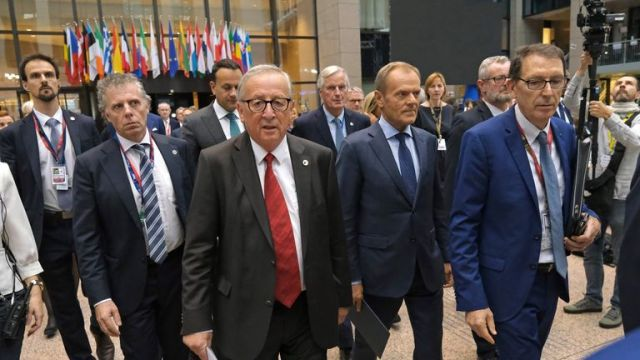 BRUSSELS, BELGIUM - OCTOBER 17: European Commission President Jean-Claude Juncker (C-L) and European Council President Donald Tusk (C-R) arrive to give statements to the media following the agreement by EU member state leaders of the Brexit deal at the summit of European Union leaders on October 17, 2019 in Brussels, Belgium. Officials announced earlier in the day that EU and UK negotiators have reached an agreement on the United Kingdoms departure from the EU. (Photo by Sean Gallup/Getty Images)