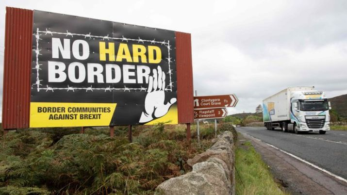 A truck passes an anti-Brexit pro-Irish unity billboard seen from the Dublin road in Newry, Northern Ireland, on October 1, 2019 on the border between Newry in Northern Ireland and Dundalk in the Irish Republic
