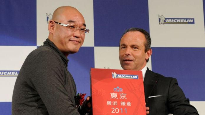 Mitsuhiro Araki (left), when he received three stars in 2010 for the first time