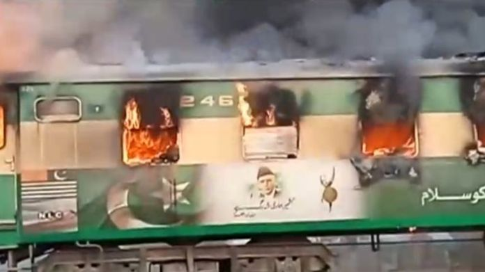 A fire burns a train carriage after a gas canister passengers were using to cook breakfast exploded