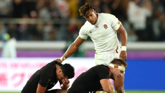 England's Anthony Watson consoles New Zealand's Anton Lienert-Brown and Sam Cane