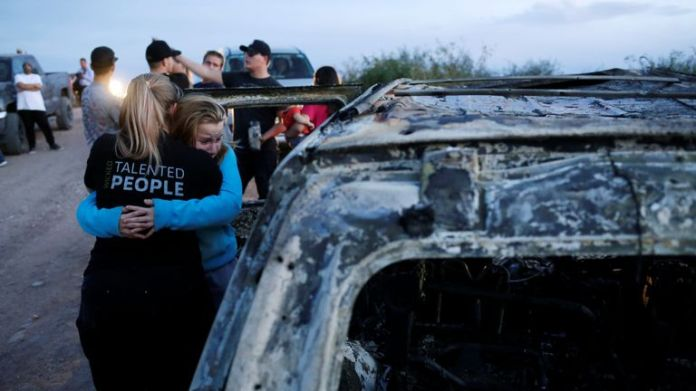 Relatives of deceased Mexican-American family members belonging to Mormon communities react to the burned wreck of a vehicle in which some of their loved ones died in Bavispe, in the state of Sonora, at Mexico, November 5, 2019. REUTERS / Jose Luis Gonzalez DAY