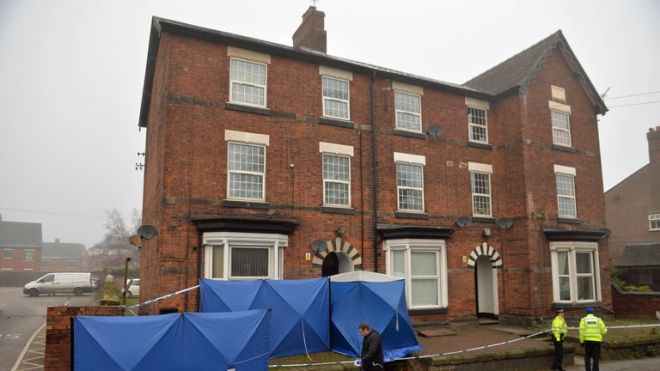 Police setting up barriers to maintain the integrity of the site at a three-storey block of flats in Woverhampton Road, Stafford, where a property is being searched by police following yesterday's stabbing attacks in London.