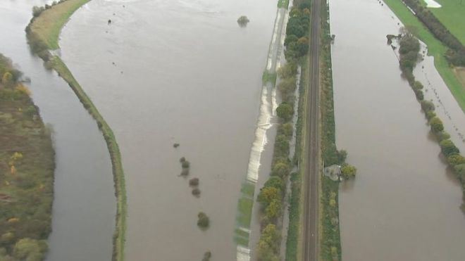 Scores of schools have been shut, roads closed and rail services cancelled due to flooding.