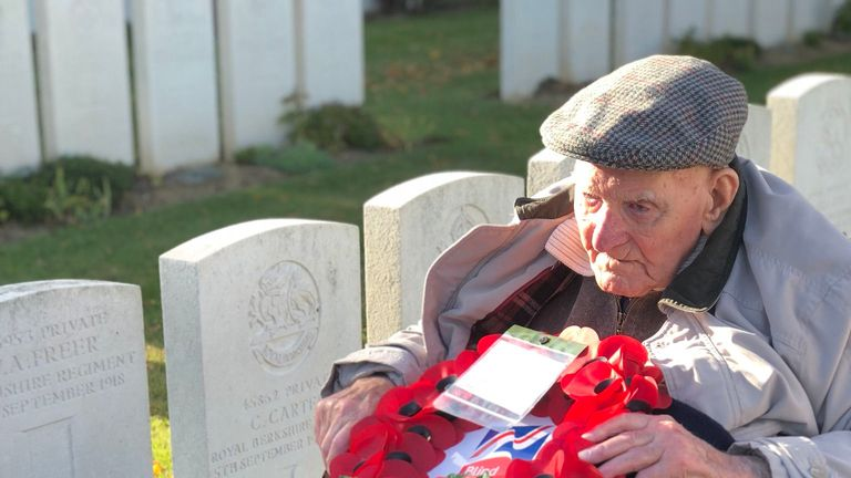 Mr Freer visits his father's grave to lay a wreath
