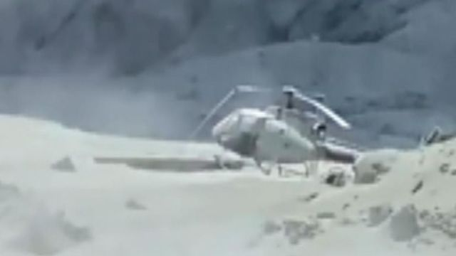 Video shows a helicopter on the ground, damaged from the ash cloud. Pic: Twitter/ @Sch