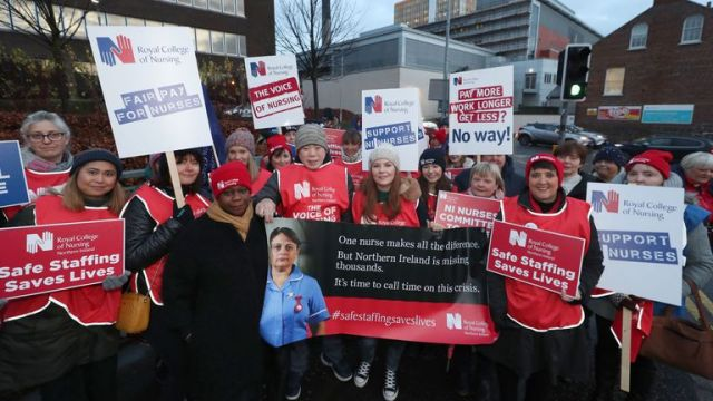 Royal College of Nursing Chief Executive and General Secretary Dame Donna Kinnair (fourth left) joins the picket line outside the Belfast City Hospital