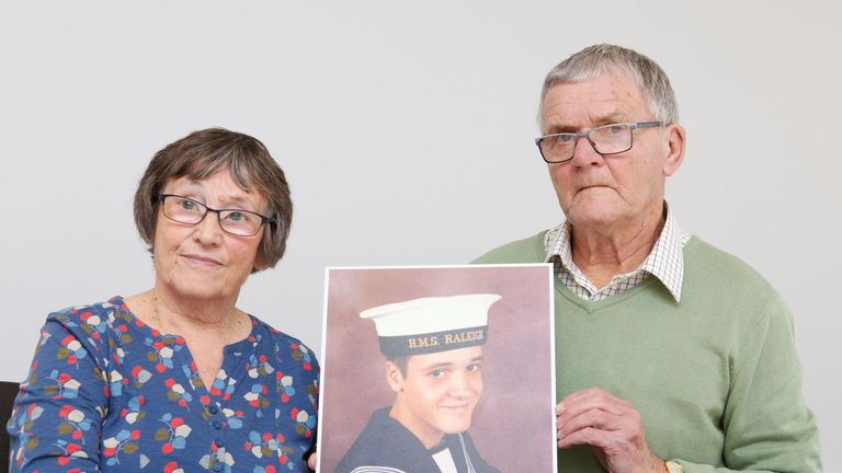 Margaret and David Parkes holding a photograph of their son Simon Parkes,