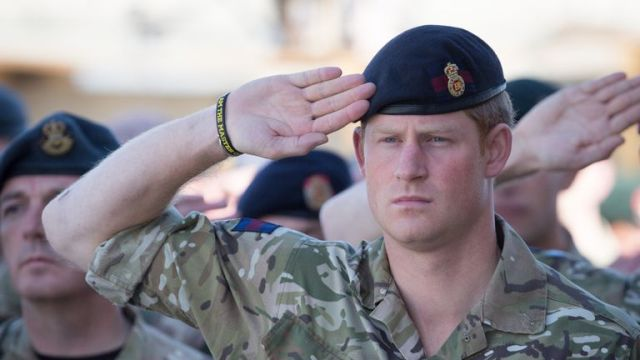 KANDAHAR, AFGHANISTAN - NOVEMBER 09: Prince Harry joins British troops and service personal remaining in Afghanistan and also International Security Assistance Force (ISAF) personnel and civilians as they gather for a Remembrance Sunday service at Kandahar Airfield November 9, 2014 in Kandahar, Afghanistan. As the the UK combat mission in Afghanistan draws to an end in 2014 this year, which also marks the 100th anniversary of the start of World War One, 70 years since the D-Day landings will be the last time British service personal will gather in any great numbers in the south of the country. (Photo by Matt Cardy/Getty Images)
