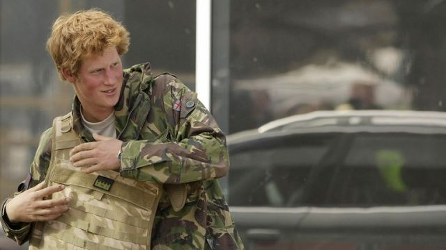 Britain 's Prince Harry takes his gear off upon his arrival at RAF Brize Norton in Oxforshire March 1, 2008, after a 10-week tour of duty in Afghanistan fighting Taliban militants with the British Army. Harry, a second lieutenant in the Blues and Royal regiment of the Household Cavalry, had been in Afghanistan since mid-December but his deployment had been kept under wraps in a deal struck between the government and British media. AFP PHOTO/SHAUN CURRY (Photo credit should read SHAUN CURRY/AFP via Getty Images)