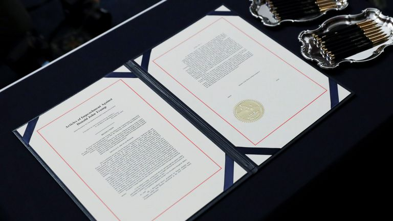 The two U.S House of Representatives articles of impeachment of President Donald Trump await the signature of House Speaker Nancy Pelosi (D-CA) before an engrossment ceremony at the U.S. Capitol in Washington, U.S., January 15, 2020. REUTERS/Leah Millis