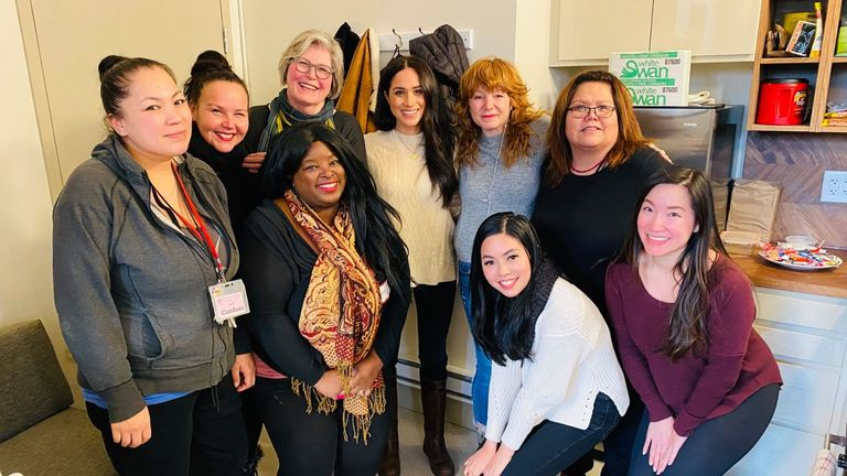 Meghan Markle with photo members of the Vancouver Women's Center Eastside Women Center: DEWC Vancouver