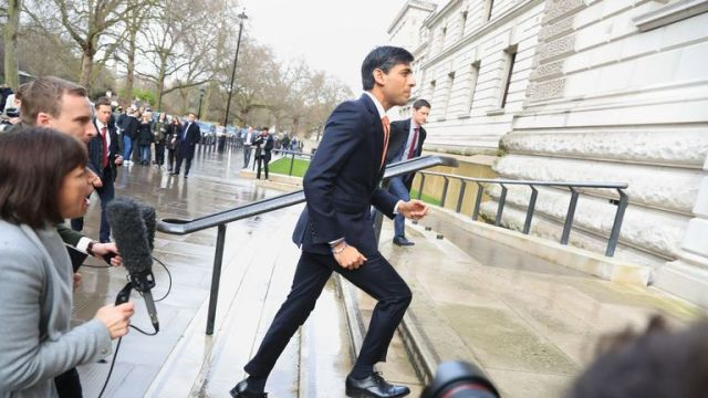 Newly installed Chancellor of the Exchequer Rishi Sunak arrives at the Treasury in London.