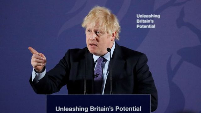 """Britain's Prime Minister Boris Johnson reacts as he delivers a speech at the Old Royal Naval College in Greenwich, south east London on February 3, 2020. - Britain on Monday said it wanted a """"thriving trade and economic relationship"""" with the European Union, as it set out its position for future trade talks after it left the bloc. But Prime Minister Boris Johnson pledged: """"We will not engage in some cut-throat race to the bottom. We are not leaving the EU to undermine European standards"""