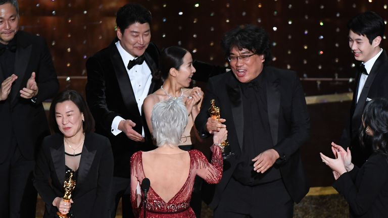 """""""Parasite"""" producers Kwak Sin-ae (L) and Bong Joon-ho (R) accept the award for Best Picture for """"Parasite"""" during the 92nd Oscars at the Dolby Theatre in Hollywood, California on February 9, 2020"""