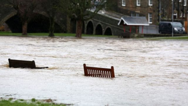 The river Tweed bursts its banks in the Scottish Borders near Peebles