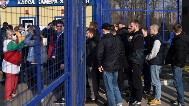 Temperature checks were in force at some football matches - social distancing was not