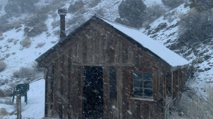 Another building in Cerro Gordo is blasted by the snowstorm. Pic: Brent Underwood