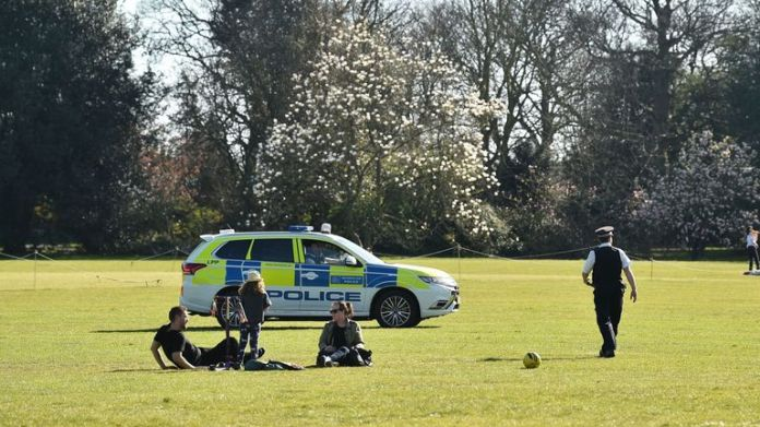 On April 4, 2020, police monitor people doing their daily exercise in Greenwich Park, south London, as life continues in the city during the new COVID-19 coronavirus pandemic. - Britain reported a record 684 new deaths from COVID-19 in its daily update on Friday, while the number of confirmed coronavirus cases has increased by 4,450 in the past 24 hours. (Photo by Glyn KIRK / AFP) (Photo by GLYN KIRK / AFP via Getty Images)