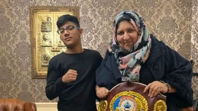 Mrs. Sadiq, a boxing fan, was seen with his 13-year-old son Zyaan