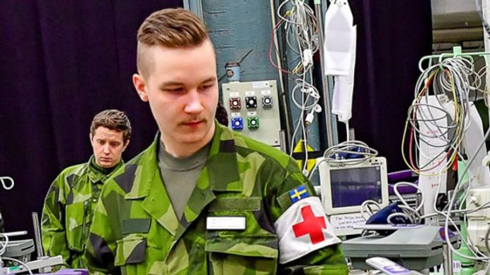 Personal and civilian construction workers from the Swedish army helped prepare a field hospital at Stockholm's international trade fair facilities