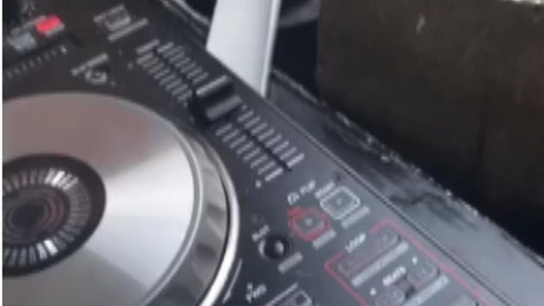 Footage shows DJ decks being used