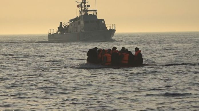 Migrants on a dinghy in the English Channel