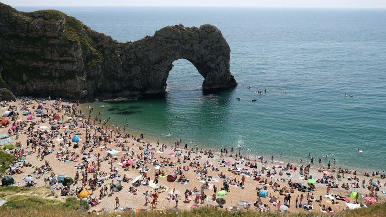 People enjoying the good weather on the beach at Durdle Door, near Lulworth in Dorset, as the public are being reminded to practice social distancing following the relaxation of lockdown restrictions.