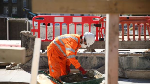 A worker is seen at work on the HS2 building site at Euston in London on May 6, 2020 as life continues under a nationwide lockdown imposed to slow the spread of the novel coronavirus. - Britain's construction sector suffered a record drop in activity during April as the coronavirus pandemic shut sites, data showed Wednesday alongside news of surging food sales at online supermarket Ocado. (Photo by ISABEL INFANTES / AFP) (Photo by ISABEL INFANTES/AFP via Getty Images)