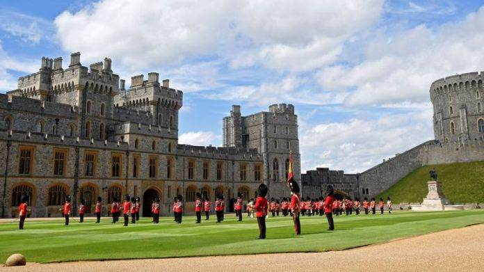 Guardsmen keep to the social distancing rules as they stand in formation for the ceremony