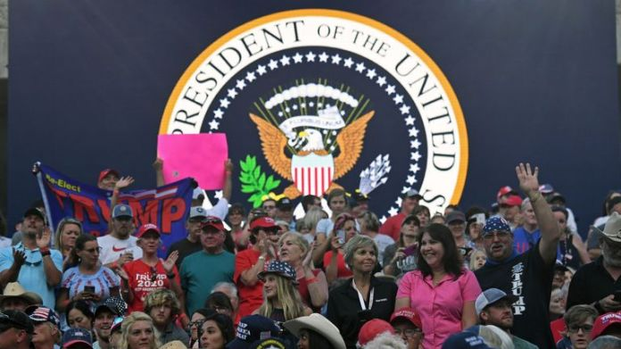 Supporters of US President Donald Trump attend Independence Day events at the Mount Rushmore National Memorial in Keystone, South Dakota, July 3, 2020. (Photo by SAUL LOEB / AFP) (Photo by SAUL LOEB / AFP via Getty Images)