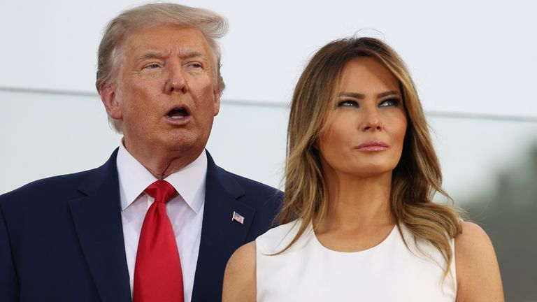 """WASHINGTON, DC - JULY 04: President Donald Trump and first Lady Melania Trump participate in an event on the South Lawn of the White House on July 04, 2020 in Washington, DC. President Trump is hosting a """"Salute to America"""" celebration that includes flyovers by military aircraft and a large fireworks display.  (Photo by Tasos Katopodis/Getty Images)"""