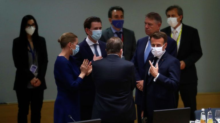 French President Emmanuel Macron (R), Sweden's Prime Minister Stefan Lofven (C), and Denmark's Prime Minister Mette Frederiksen (L) speak during a round table meeting at an EU summit over a post-virus economic rescue plan in Brussels, on July 20, 2020. - EU leaders were gathered for a fourth day on July 20 during a summit to try to unblock a multi-billion-euro bundle of loans and direct aid to drag Europe out of the recession caused by the pandemic. (Photo by Francisco Seco / POOL / AFP) (Photo by FRANCISCO SECO/POOL/AFP via Getty Images)