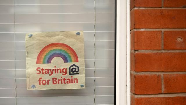A poster depicting the colours of a rainbow, being used as symbols of hope during the COVID-19 pandemic, is pictured in the window of a house in Manchester, north west England, on May 1, 2020, as life in Britain continues during the nationwide lockdown due to the novel coronavirus pandemic. - The death rate from coronavirus in England is more than twice as high among people in disadvantaged areas, according to official data published Friday.  There were 55.1 deaths per 100,000 people involving coronavirus in the areas with the worst rankings for income, health, education and crime -- compared to 25.3 in the least-deprived areas, according to the Office for National Statistics (ONS). General mortality rates involving all causes of deaths, including COVID-19, were 88 percent higher in the most deprived areas than in the least. (Photo by Oli SCARFF / AFP) (Photo by OLI SCARFF/AFP via Getty Images)