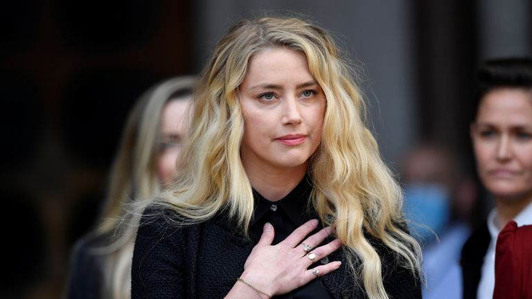 Actor Amber Heard delivers a statement as she leaves the High Court